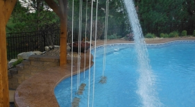 Swim-up-bar-rope-swing-cantiliever-coping-fire-bowl-rain-decent-waterfall-underwater-speaker