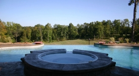 Negative-edge-pool-and-spa-water-bowl-free-form-sheer-decent-stamped-concrete-boarder