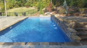St.-Charles-County-two-tiered-deck-rectangle-pool-stacked-stone-raised-wall-stone-coping