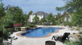 Broom-finish-concrete-stacked-stone-sheer-decent-water-feature-Viking-fiberglass-Cancun