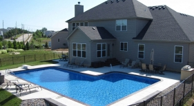 L-shape-true-L-pool-vinyl-liner-tumbled-rock-landscape-retaining-wall-diving-board-sprayers