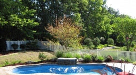 Seamless-slate-stamped-concrete-deck-sheer-decent-waterfall-water-feature-freeform