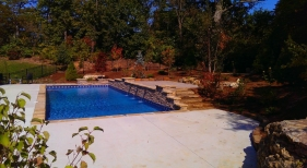 St.-Charles-County-rectangle-pool-with-water-feature-copper-scupper-fall-colors-stacked-stone-coping