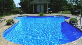 Vinyl-liner-color-coordinates-sealed-steel-handrails-planter-water-feature-with-pool-house