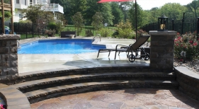 Step-up-tiered-deck-step-down-firepit-offset-grecian-geometric-latham-Ft-Wayne-strong-support