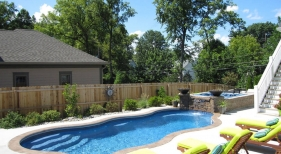 Pool patio composite deck pool spa combo Viking fiberglass stamped concrete coping.