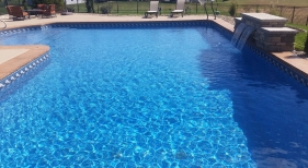 Geometric vinyl pool with raised sheer descent