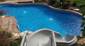 Fun-ride-slide-Dardenne-Prairie-deck-jet-water-feature-stamp-concrete-2-tone-concrete-pool-coping
