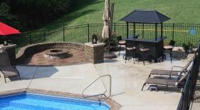 Step-down-conversation-area-off-pool-pillar-bar-paver-natural-firepit-fireplace-Fenton