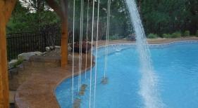 Swim-up-bar-rope-swing-cantiliever-coping-fire-bowl-rain-decent-waterfall-underwater-speaker