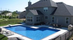 L-shape-true-L-pool-vinyl-liner-tumbled-rock-landscape-retaining-wall-diving-board-sprayers